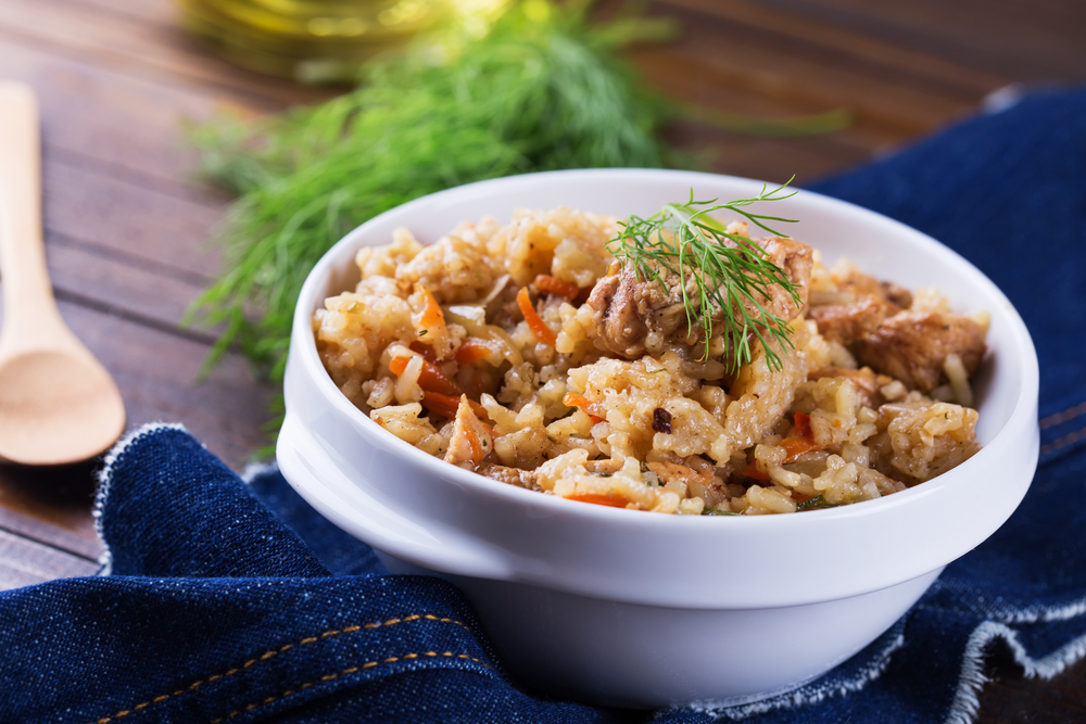 Cordero con salsa y arroz